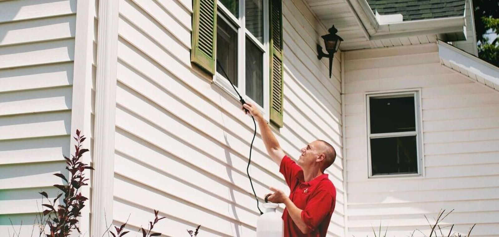 larry spraying window